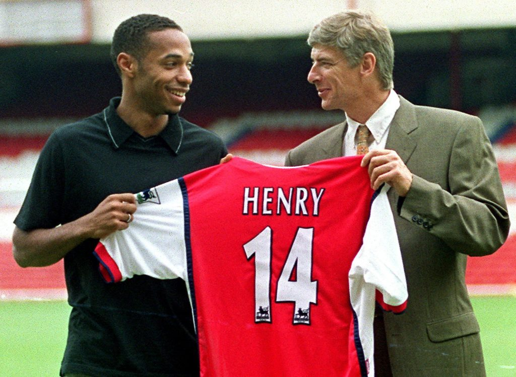 Striker Thierry Henry (L) holds up his shirt with