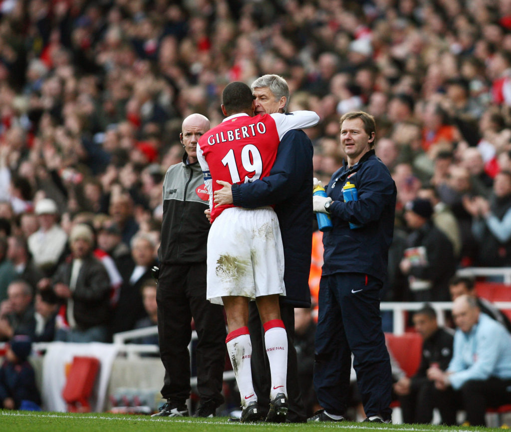 Arsenal's Captain Gilberto Silva (C) hug