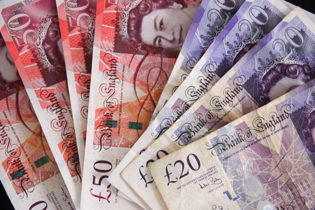 Fifty pounds bank notes are seen in this photo illustration